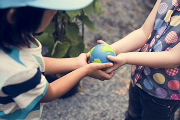 Two Children Holding Small Globe Ball