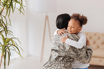 Military Mother Hugging Daughter