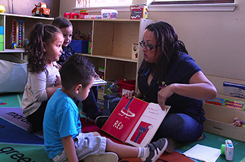 Child Care Provider Reading to Children