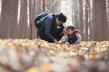 Asian Father and Son Outside in Woods