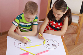 Two Children Drawing and Coloring